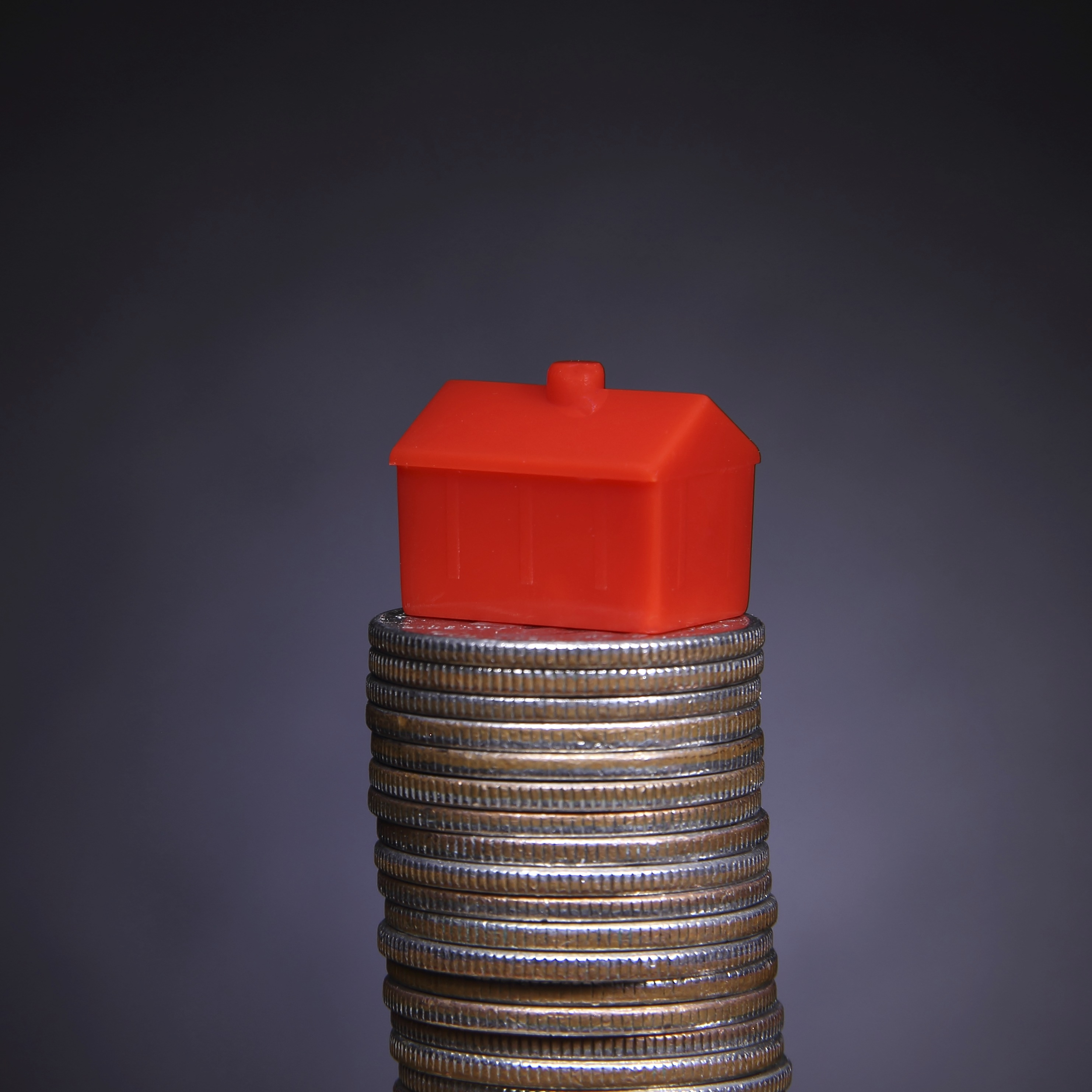 """alt=""""house on stack of coins"""""""