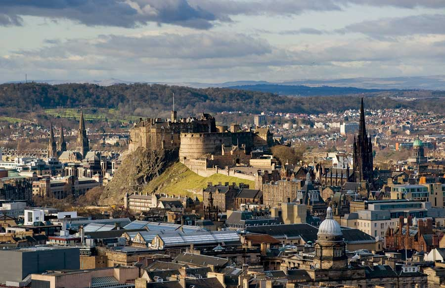 Property investment Edinburgh. A photo of Edinburgh with the castle prominent in the foreground.